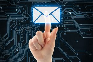 An image featuring a person holding out his index finger which has an email security logo on it