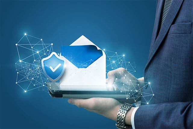 An image featuring a person holding a laptop that has an email security logo on it