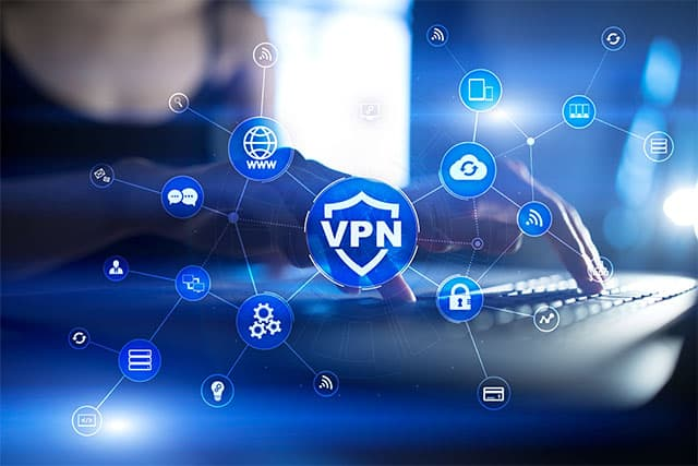 An image featuring a person using a laptop with a VPN logo in front of the whole image