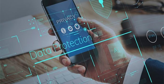An image featuring a person holding his phone that says privacy on it representing data protection